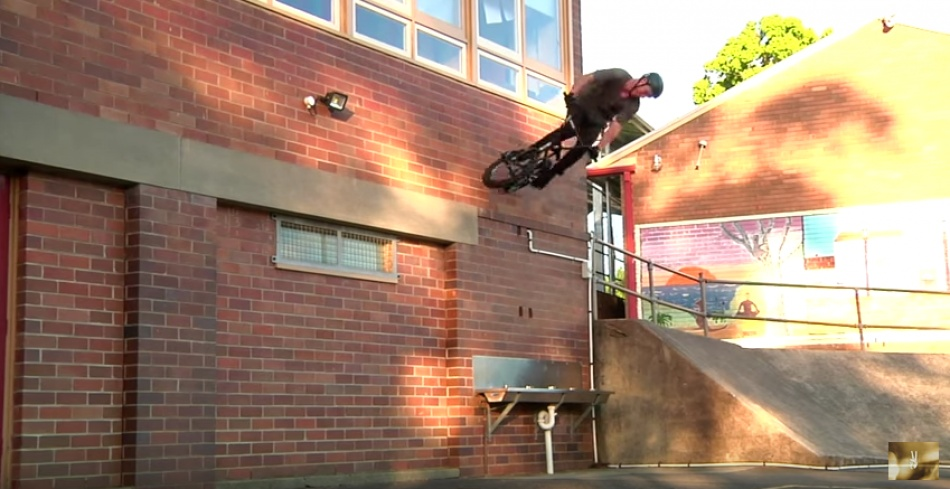 Boyd Hilder ready to go 180 out of this wallride.