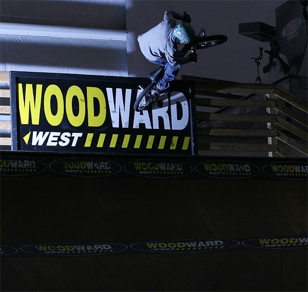 Shawn Dorton walltaps a Woodward sign